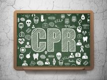 Health concept: CPR on School board background Stock Images