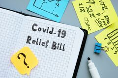 Health concept meaning covid relief bill with phrase on the sheet