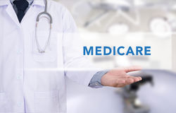 Health concept - MEDICARE. On Medical Doctor holding hands stock image