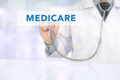 Health concept - MEDICARE. Medicine doctor hand working, Health concept - MEDICARE sign virtual screen stock photography