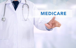 Health concept - MEDICARE. Medicine doctor working with computer interface as medical stock image