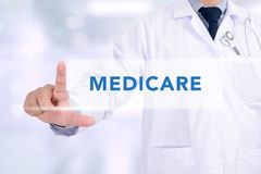 Health concept - MEDICARE. Medicine doctor working with computer interface as medical concept stock photo