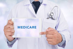 Health concept - MEDICARE. Tablet with the medical Health concept - MEDICARE on the display royalty free stock image
