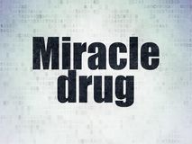 Health concept: Miracle Drug on Digital Data Paper background Stock Photos