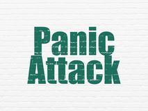 Health concept: Panic Attack on wall background. Health concept: Painted green text Panic Attack on White Brick wall background Royalty Free Stock Photo