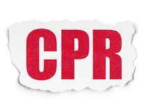 Health concept: CPR on Torn Paper background Stock Images