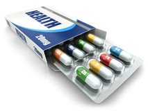 Health concept. Vitamin pills in box. Royalty Free Stock Images