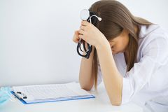 Health concept. Young female doctor on modern clinic background stock photos