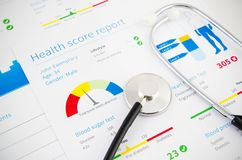 Health condition score report. Stethoscope on medical background stock images