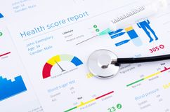 Health condition score report. Stethoscope on medical background royalty free stock images