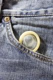 Health - condom in jeans pocket Royalty Free Stock Image