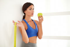 Health-conscious latin lady dieting on apple Royalty Free Stock Photography