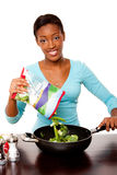 Health conscious woman preparing vegetables Stock Images