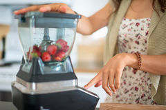Health conscious woman using a blender Stock Image