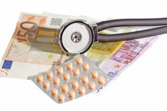 Health Costs. Stethoscope and pills on Euro bills - isolated on white background Stock Photography