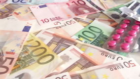 Health costs concept - pills and euro money stock footage