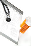 Health Diagnosis. Health care concept featuring lab test results, pill bottles and stethoscope Royalty Free Stock Photos