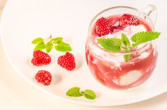 Health and diet concept/glass with yogurt or milk, fresh berries and mint over white stock photo