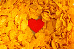 Health diet concept, healthy breakfast. Love corn flakes background Royalty Free Stock Photo
