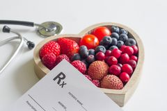 Health diet with heart stethoscope and medical prescription concept. On white royalty free stock photo