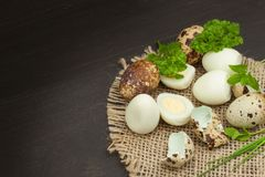 Health & Diet quail eggs on the kitchen table. Some fresh eggs of quail on the table. Quail eggs ready to eat. Stock Images