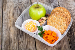 Health and Fitness food in lunch box on wooden background Royalty Free Stock Photos