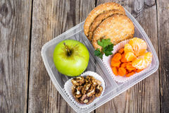 Health and Fitness food in lunch box on wooden background Royalty Free Stock Images