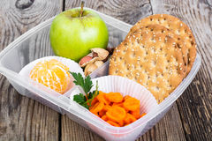 Health and Fitness food in lunch box on wooden background Royalty Free Stock Image