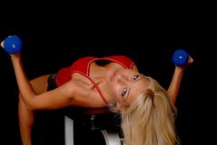 Health and Fitness Girl. Beautiful young blond lady doing a fitness workout Royalty Free Stock Image