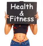 Health And Fitness Sign Shows Exercise For Getting Healthy Stock Image