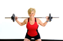 Health and Fitness Weight Workout. Woman lifting weight at wellness center Royalty Free Stock Photography