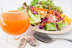 Health food. Orange juice with peanuts and salad Royalty Free Stock Image