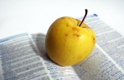 Health food. Yellow apple is a health food Royalty Free Stock Photo