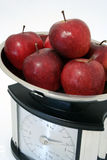 Health food. Apples and weight scale Stock Images