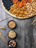 Health food background border with dried apricot, raisin, grains, seeds, nuts, beans Food high in antioxidants, smart royalty free stock image