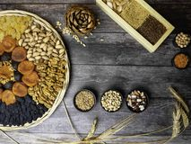 Health food background border with dried apricot, raisin, grains, seeds, nuts, beans Food high in antioxidants, smart stock photography