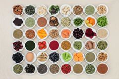 Health Food for the Brain. With a super food collection of herbs and spices used in herbal medicine and supplement powders. High in omega 3 fatty acids stock photos
