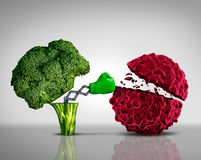 Health Food. And Cancer fighting foods nutrition concept with a green boxing glove emerging out of an open broccoli vegetable as a health care metaphor for a Stock Photos