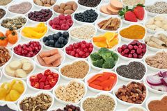 Health Food Chioce. Health food for a healthy heart concept with vegetables, fruit, fish, nuts, seeds, supplement powders, pulses, cereals and herbs used in Stock Images