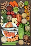 Health Food Collection. Health food concept with fresh seafood, vegetables, fruit, seeds, grains, cereals, herbs and spices with foods high in omega 3 fatty Royalty Free Stock Image
