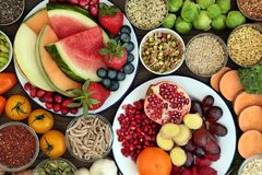 Eat Well for Good Health. Health food concept with fresh t, vegetables, seeds, pulses, grains and cereals with foods high in vitamins, minerals, anthocyanins Stock Photo