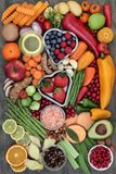 Health Food for Fitness. Concept with fresh fruit, vegetables, herbs, spices, nuts, himalayan salt and olive oil. High in antioxidants, fiber, smart royalty free stock photos