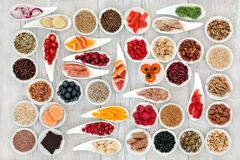 Health Food for a Healthy Heart. With fish, vegetables, fruit, nuts, seeds, pulses, spice and medicinal herbs. Super food concept. High in omega 3 fatty acid stock photos