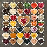 Health Food for a Healthy Heart. With vegetables, fruit, fish, nuts, seeds, grain, cereals with herbs and spices used in herbal medicine. High in omega 3 fatty royalty free stock photos