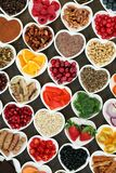 Health Food for a Healthy Heart. With vegetables, fruit, fish, nuts, seeds, supplement powders, cereal and herbs for herbal medicine. High in omega 3 fatty acid royalty free stock image