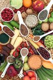 Health Food for a High Fibre Diet. With fruit, vegetables, legumes, nuts, seeds and cereals. Foods with antioxidants, anthocyanins, vitamins and minerals. Top royalty free stock image