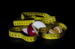 Health food with measuring tape Stock Photography