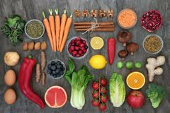 Health Food to Slow the Ageing Process. Health food to slow ageing process concept including fruit, vegetables, spices and herbs used in herbal medicine Very stock image