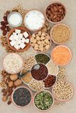 Health Food for Vegans. With tofu, legumes, nuts, seeds, cereals, soya yoghurt, milk and chunks with foods high in fiber, antioxidants, vitamins and minerals on Stock Image