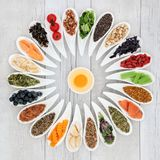 Health Food Wheel. With ingredients to improve brain power. Super foods concept high in minerals, vitamins, antioxidants, omega 3 and anthocyanins Royalty Free Stock Photos
